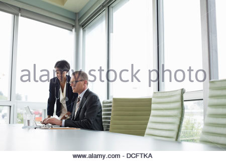 Medical professionals reviewing information on laptop - Stock Photo
