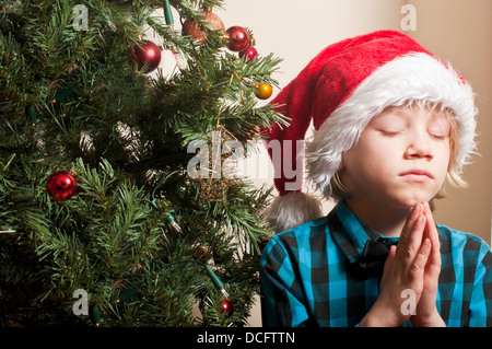 Praying for Christmas - Stock Photo