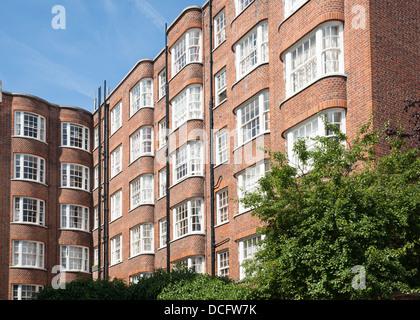 Row of red brick apartments in Mayfair, London, UK Stock Photo ...