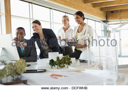 Group of sustainable energy engineers working together - Stock Photo