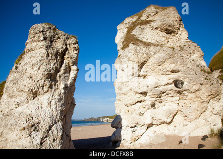 Landmark Rock Formations On Beach; White Rocks Beach, Portrush, Country Antrim, Northern Ireland - Stock Photo