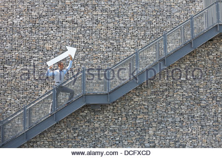 Businessman pointing the way forward - Stock Photo
