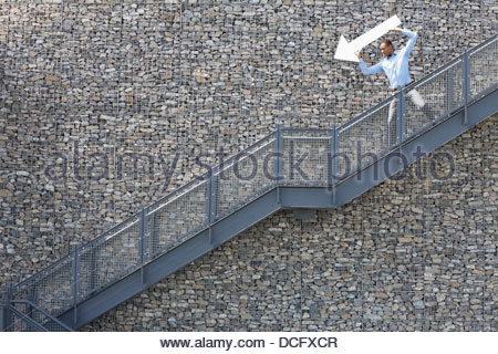 Businessman pointing the way down - Stock Photo