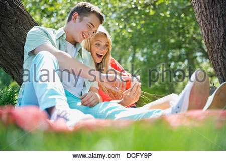 Teenagers using smart phone - Stock Photo