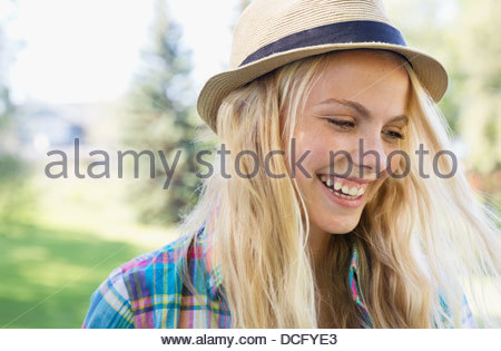 Portrait of teenage girl wearing a hat - Stock Photo