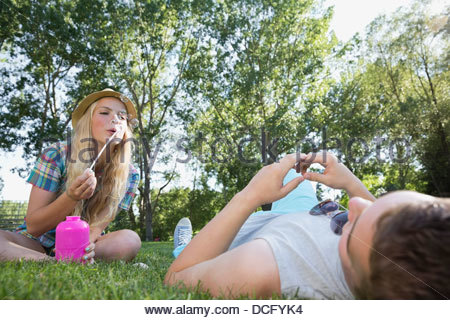 Teenage girl blowing soap-bubbles - Stock Photo