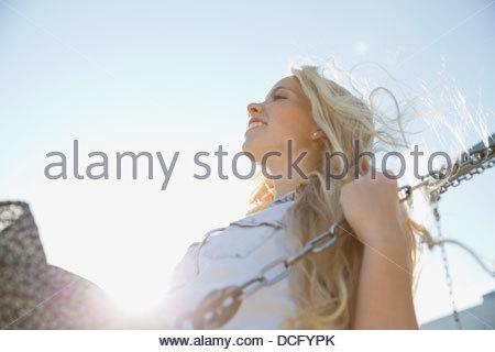 Teenage girl on swing - Stock Photo