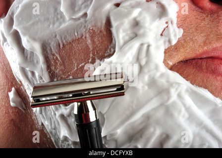 one wet shaving razor and some foam in a face - Stock Photo