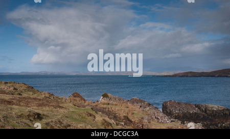 Dramatic rain clouds passing over Enard Bay on the north west coast of Scotland, UK - Stock Photo