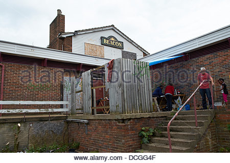Nottingham, UK. 17th Aug, 2013. Work starts on rejuvenating a derelict pub for the community uise.  The Beacon  - Stock Photo