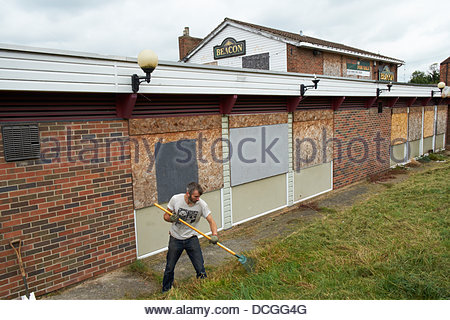 Nottingham, UK. 17th Aug, 2013. Martin Sommerville clears grace as the first step in rejuvenating  a derelict pub - Stock Photo