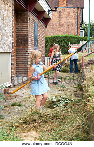 Nottingham, UK. 17th Aug, 2013. Even the youngest can help with the work of bringing a derelict pub back into use. - Stock Photo