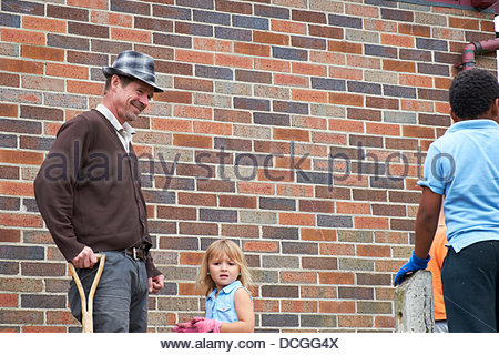 Nottingham, UK. 17th Aug, 2013. Howie Smith and his daughter share a joke with a young volunteer at The Beacon  - Stock Photo