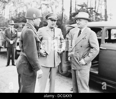 World War II photo of President Harry Truman talking to General Eisenhower and Hickey. - Stock Photo