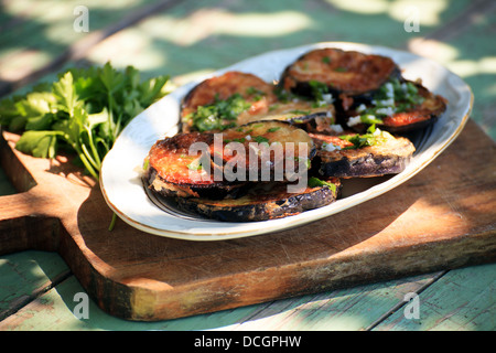fried eggplant with fresh garlic and parsley - Stock Photo
