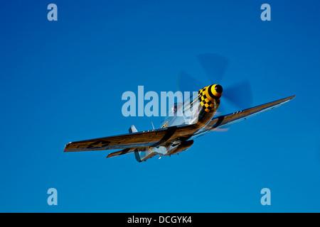 A North American P-51D Mustang Kimberly Kaye in flight near Chino, California. - Stock Photo