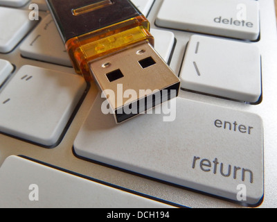 Flash drive on keyboard buttons - Stock Photo