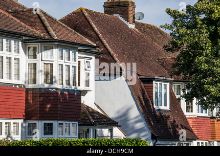 Close up of typical 1930s house tops, in a side road, just off the High Street in Banstead, Surrey, England, UK. - Stock Photo