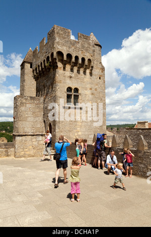 Tourists at Chateau be Beynac, or castle, Beynac et Cazenac village, the Dordogne, France, Europe - Stock Photo