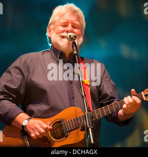 Simon Nicol lead singer and guitarist of Fairport Convention on stage at the band's Cropredy Festival in 2013 - Stock Photo