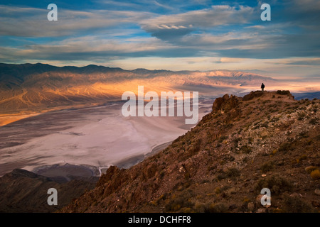 Tourist overlooking Panamint Mountains over Badwater Basin, from Dantes View, Death Valley National Park, California - Stock Photo
