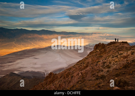 Tourists overlooking Panamint Mountains over Badwater Basin, from Dantes View, Death Valley National Park, California - Stock Photo