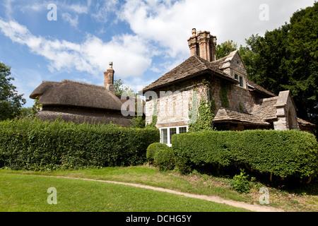 Sweetbriar Cottage with Circular Cottage in the background, Blaise Hamlet, Henbury, Bristol, England, UK. - Stock Photo