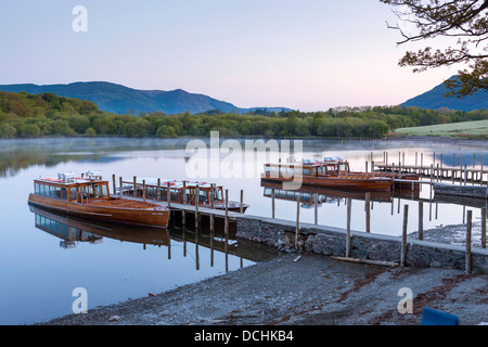 Boats on Derwent Water at sunrise, Keswick, Lake District National Park, Cumbria, England, UK, Europe. - Stock Photo
