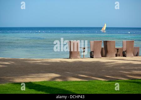 Beach and sail boat in Hurghada Egypt - Stock Photo