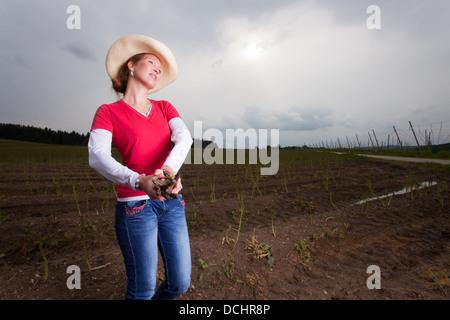asparagus farmer on a field - Stock Photo