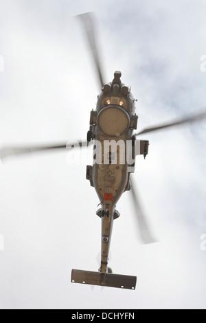An MH-60R Seahawk of the U.S. Navy in flight over Coroando Beach, California. - Stock Photo
