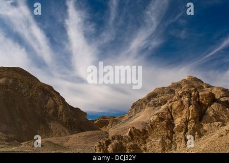 Cloud & Eroded hillside, Twenty Mule Team Canyon, Death Valley National Park, California - Stock Photo