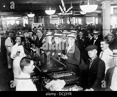 Interior of a crowded bar moments before midnight, June 30, 1919, when prohibition went into effect New York City - Stock Photo