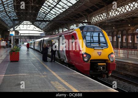 Virgin Voyager 'John Cabot' 221102 with new front side panels and sister class John Cabot, at Preston Railway Station, - Stock Photo