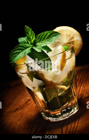 Mojito cocktail on rustic wooden background - Stock Photo