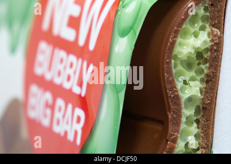Nestle Mint aero new bubbly big bar of chocolate with piece broken off to see inside - Stock Photo