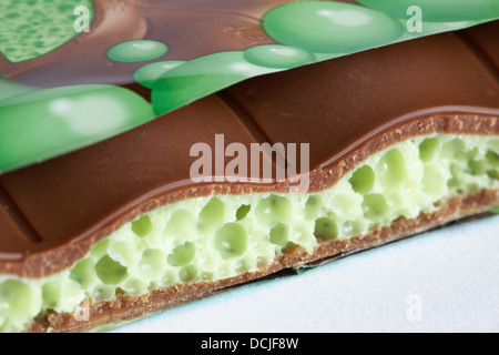 Nestle Mint aero new bubbly big bar of chocolate  with piece broken off to see inside set on white background - Stock Photo