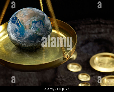 detail of historic scales with globe on it and metallic weights in dark back - Stock Photo