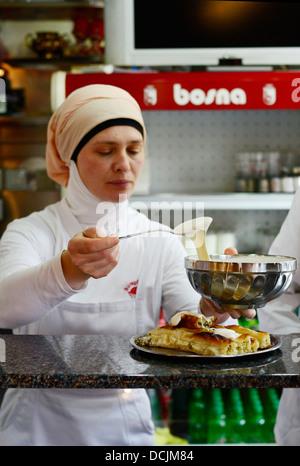 The popular Pita & Burek prepared in the Bosna buregdzinica in the old city of Sarajevo. - Stock Photo