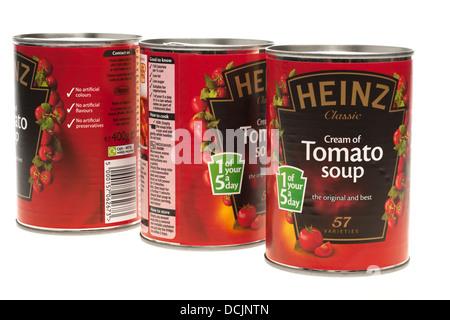Three tins Heinze cream of tomato soup - Stock Photo
