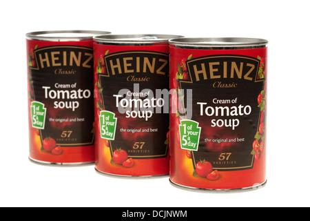 Three tins of Heinz tomato soup - Stock Photo