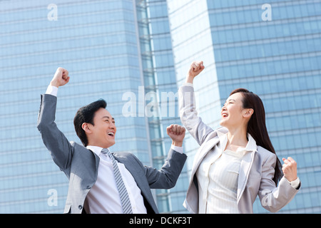 Excited business partners punching the air - Stock Photo