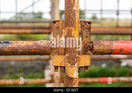 Scaffolding poles attached together - Stock Photo