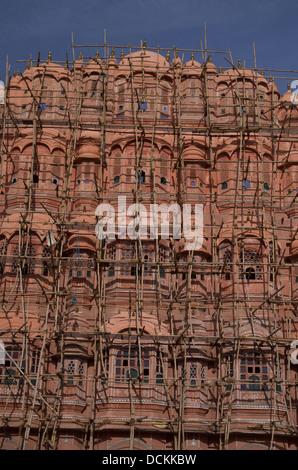 Bamboo scaffolding outside  Hawa Mahal  ( Palace of Winds ) - Jaipur, Rajasthan, India - Stock Photo