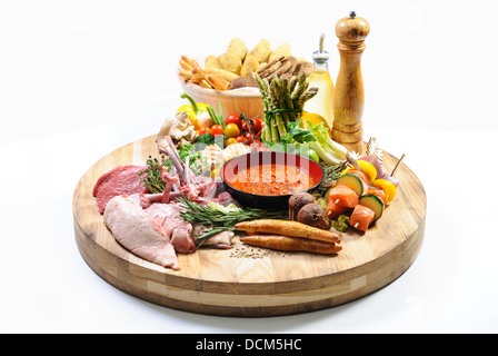 Raw food on a wooden board - Stock Photo