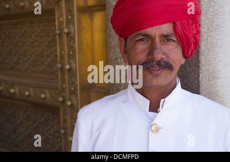 Indian Guard with red turban at City Palace - Jaipur, Rajasthan, India - Stock Photo