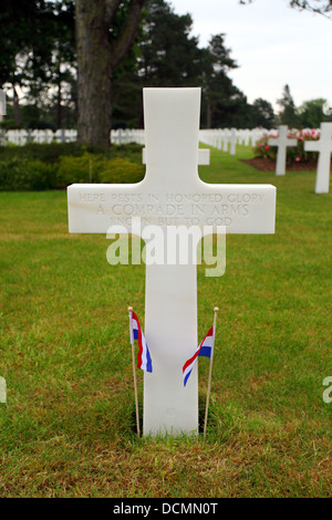 Gravestone to mark the grave of an unknown soldier. - Stock Photo
