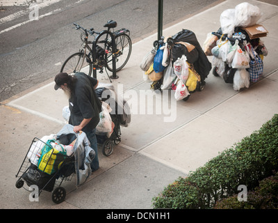 A homeless man with his possessions in the Chelsea neighborhood of New York on Friday, August 16, 2013. (© Richard - Stock Photo