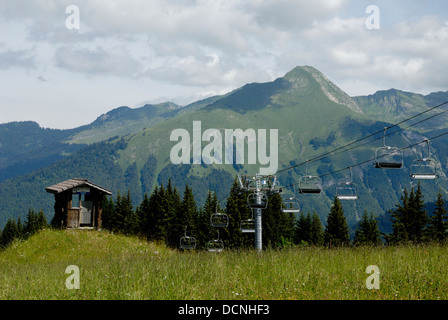 Ski lifts with mountains behind in the French alps, Summer time, France - Stock Photo