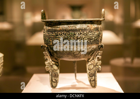 Bronze ritual food container, Ding, Shang dynasty, 15th-14th century B.C. with flat legs and scalloped profile. - Stock Photo